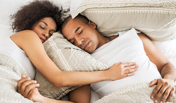 couple sleeping in bed image