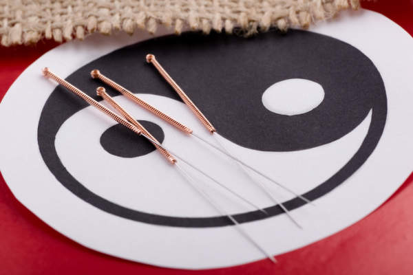 yin and yang, acupuncture needles, qi energy concept in alternative medicine.