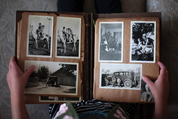 Person holding old photo album