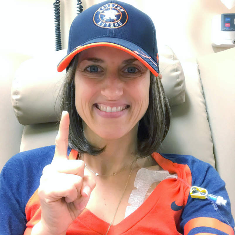 Sabrina Skiles at chemo holding up one finger