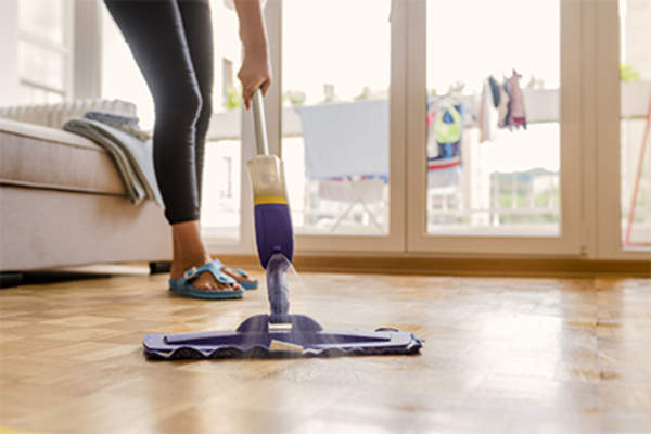 Woman using a Swiffer mop.