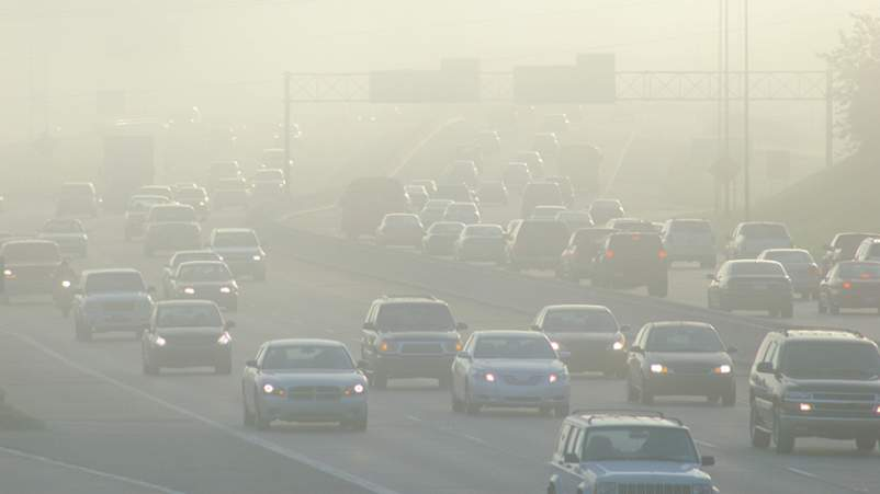 Smog and air pollution with cars on highway.