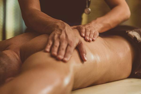 Oil Massage of Male Torso