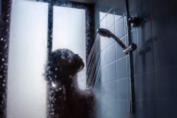 silhouette of woman in shower