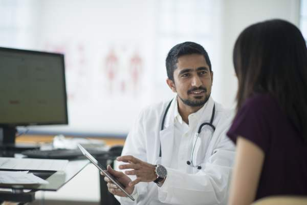 doctor talking to patient image