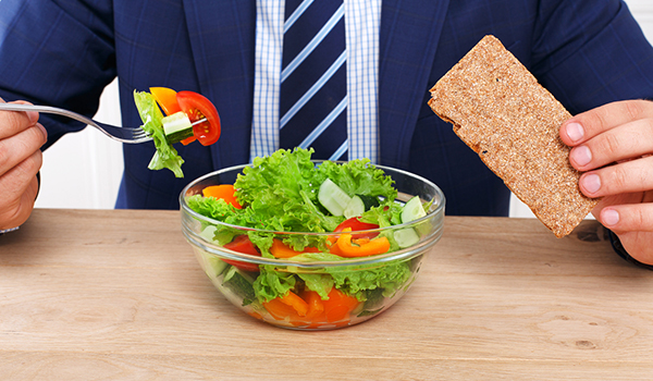 Man eating salad for lunch.