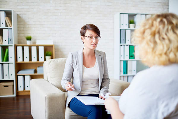Therapist talking to patient.