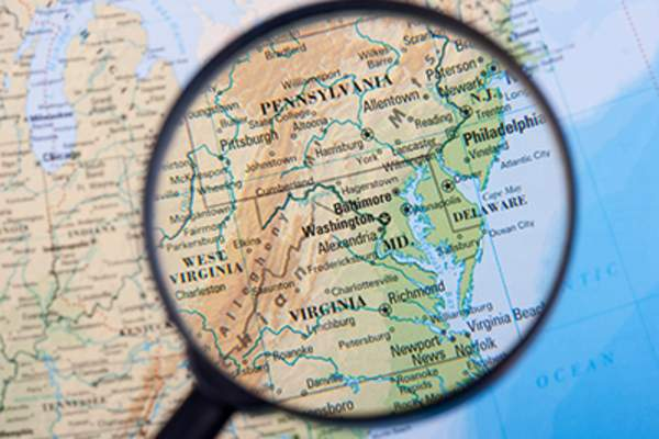 Map of east coast of the United States under a magnifying glass.