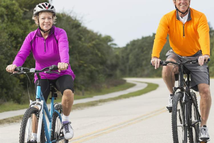 A couples stays healthy by riding bikes together.