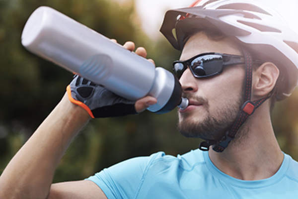 Cyclist drinking from a water bottle.