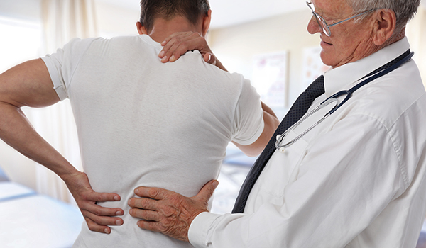 Doctor examining his patient's pain points.