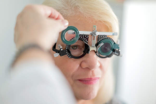 senior woman getting eye exam