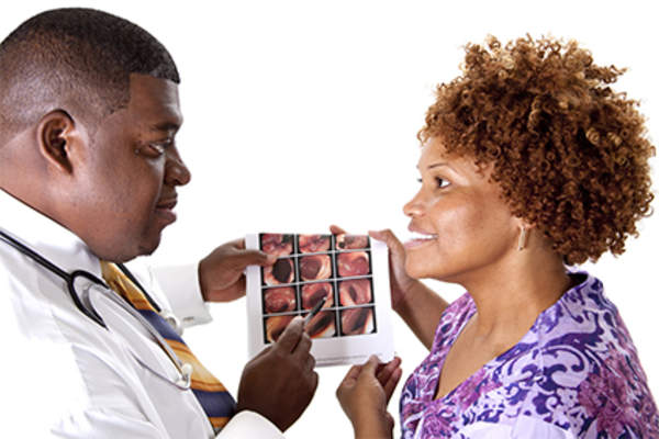 Doctor discussing colonoscopy results with female patient.