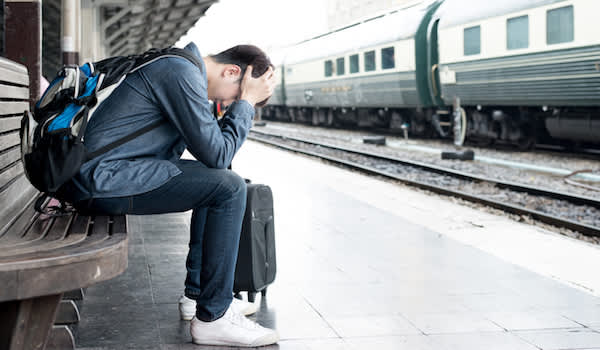 Travel anxiety affecting male traveler.