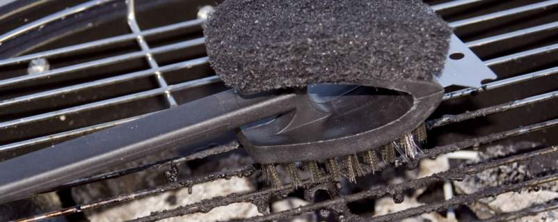 grill brush on a grill