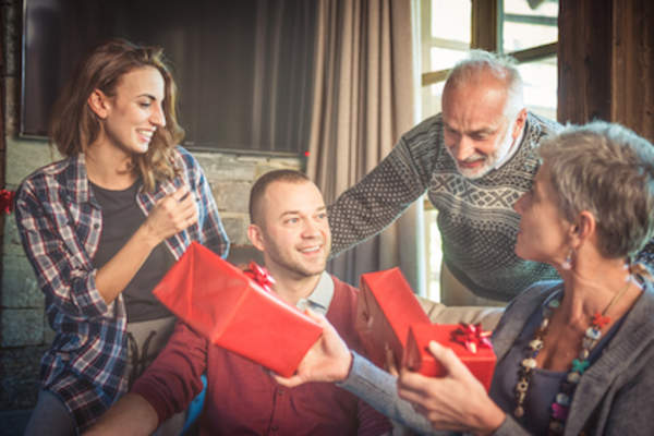 Family exchanging Christmas gifts.