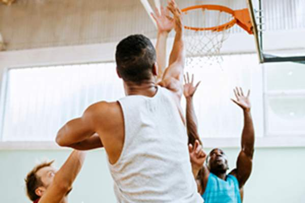 men playing basketball image