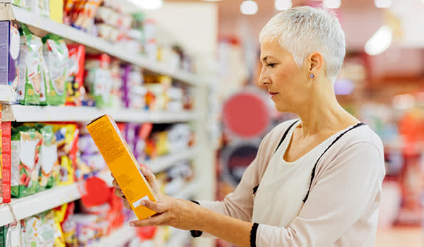 woman reading food label image