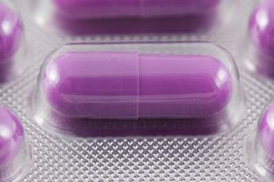 Purple acid-reducing pill in blister pack.