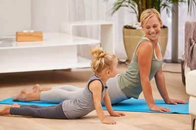 Mother and daughter doing yoga together.