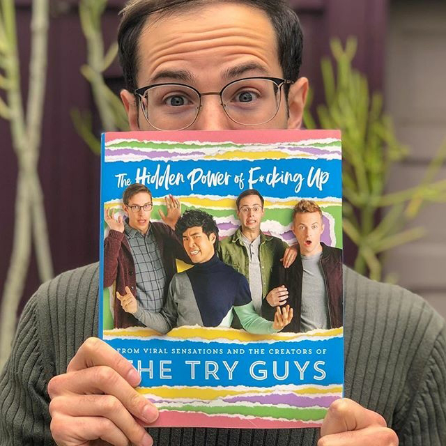"Zach Kornfeld holding a copy of the book ""The Hidden Power of Fucking Up."""
