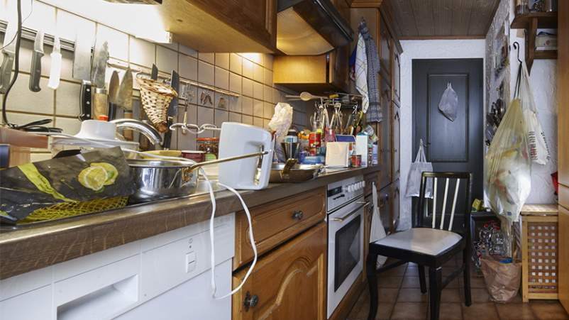 Messy, cluttered kitchen.