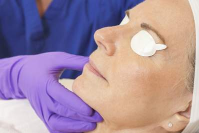 Woman gets laser treatment on her face.