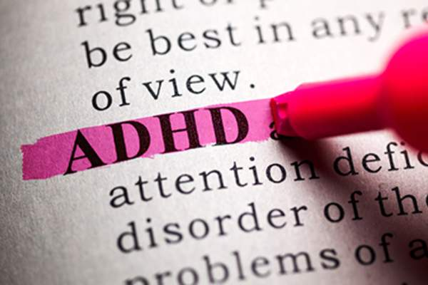 Highlighting ADHD definition in a book.