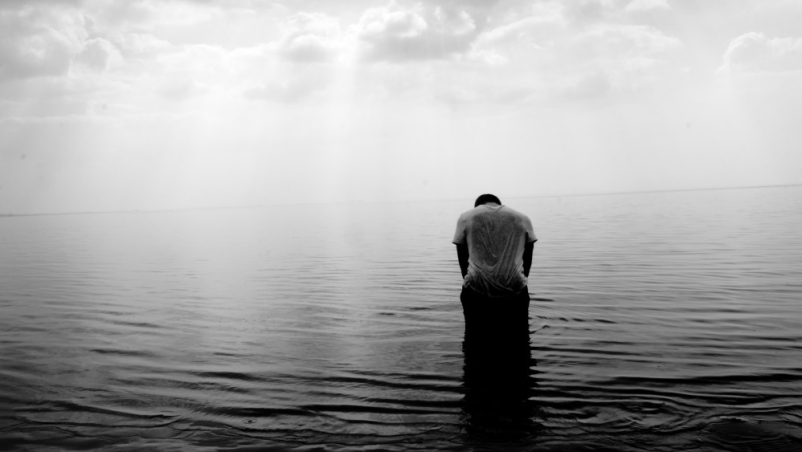 depressed man alone in water