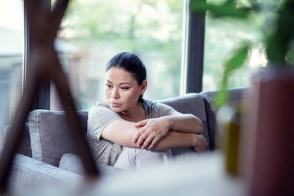 woman in living room feeling worthless.