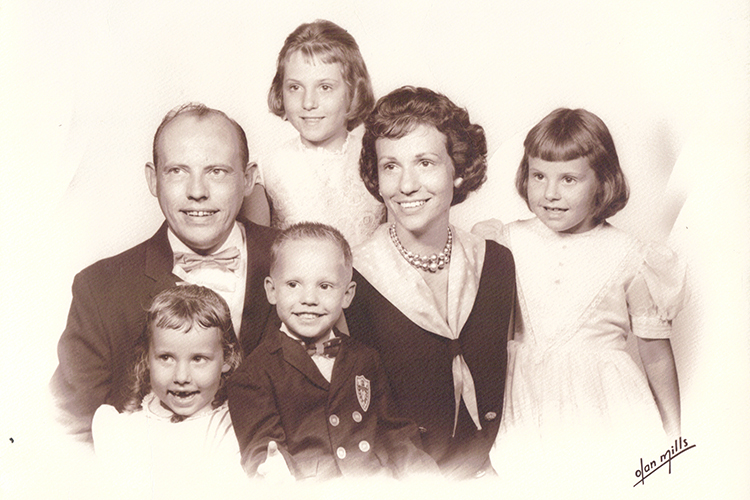 Family portrait of Eileen Bailey with her father, mother, two sisters, and brother from 1964.