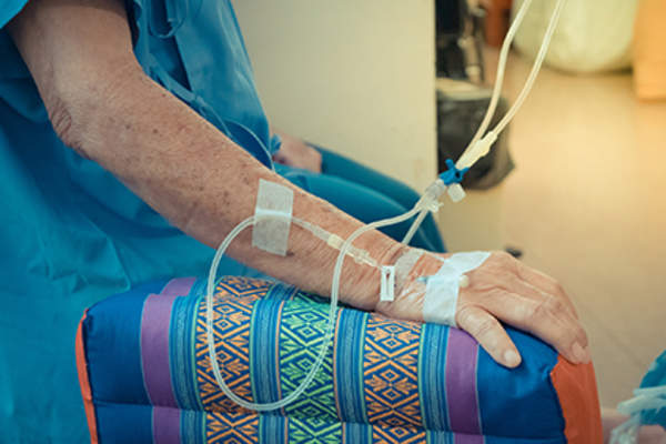 Cancer patient receiving chemotherapy treatment.