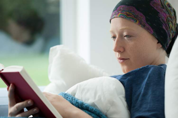 Woman with cancer reading.