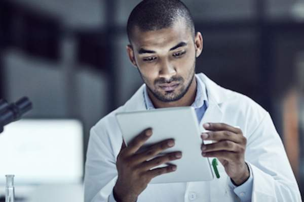 Researcher reviewing exercise study results on tablet.