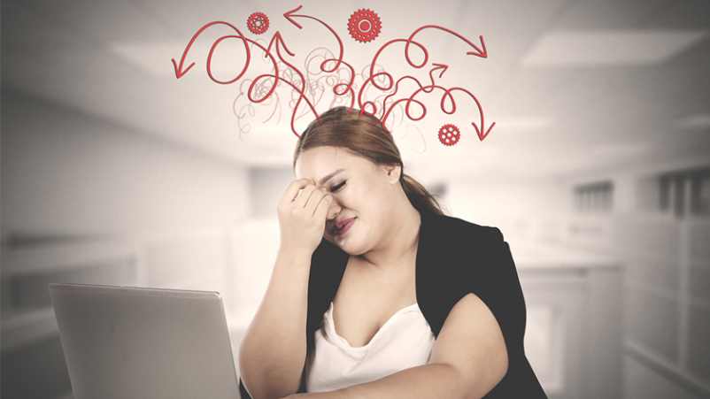 Overweight woman stressed at work.