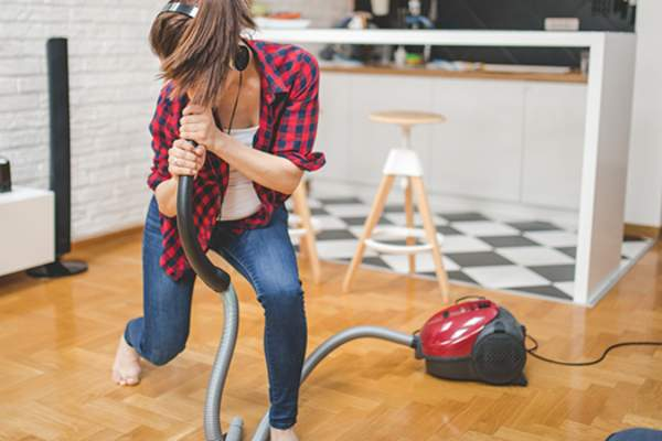 woman dancing while vacuuming image