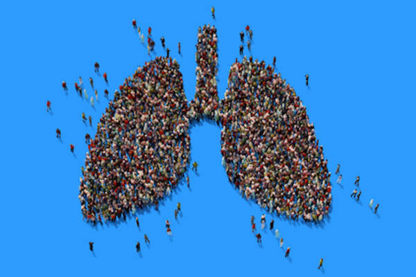 Crowd of people forming lung image.