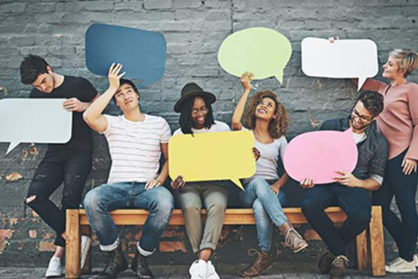 Group of people holding speech bubbles.