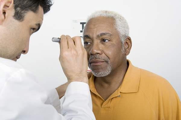 Senior man getting eye exam.
