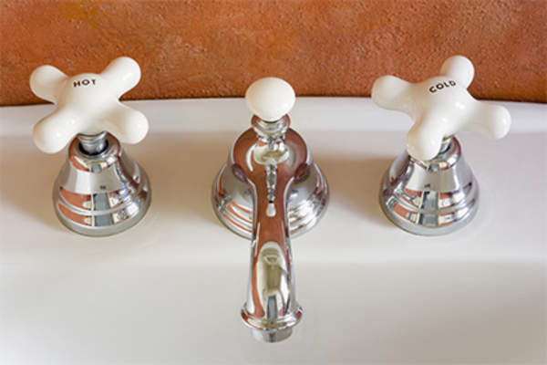 Hot and cold water spigots in sink.