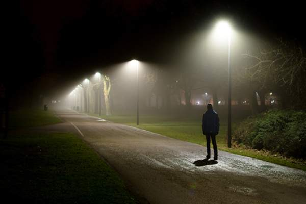 man on the street alone at night image