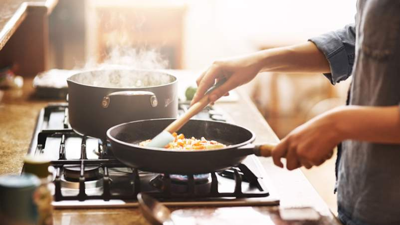 Cooking new diet on stove.