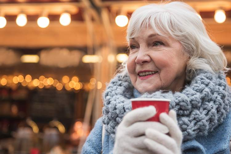 Independent, healthy, happy senior woman drinking a warm beverage.
