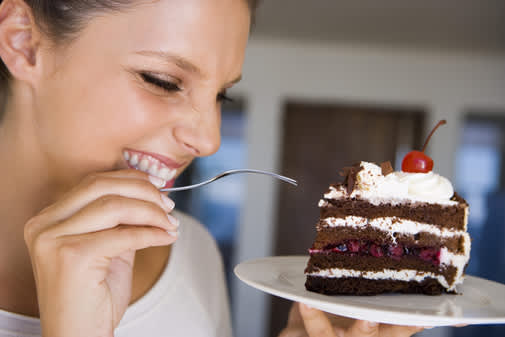 woman smiling with piece of cake