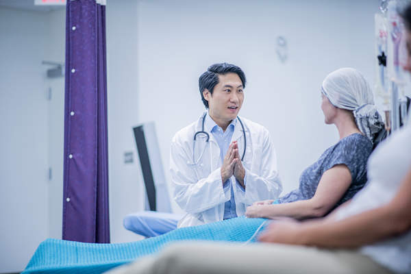 Doctor talking to cancer patient undergoing chemotherapy