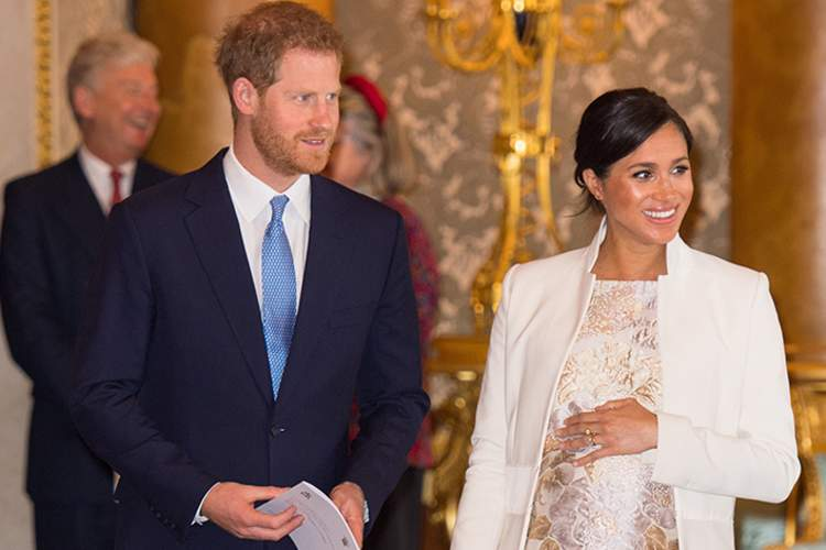 Meghan, Duchess of Sussex and Prince Harry, Duke of Sussex attend a reception to mark the fiftieth anniversary of the investiture of the Prince of Wales at Buckingham Palace on March 5, 2019 in London, England.