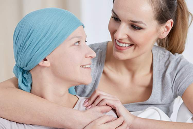 Hugging a friend who has cancer.