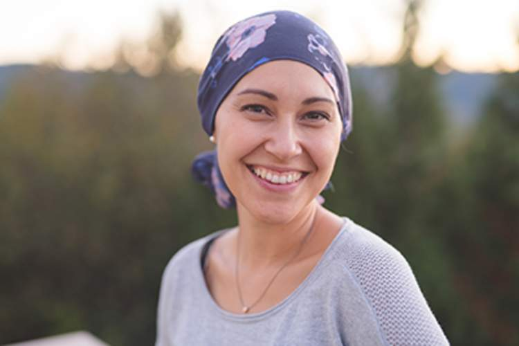 Woman with cancer smiling.