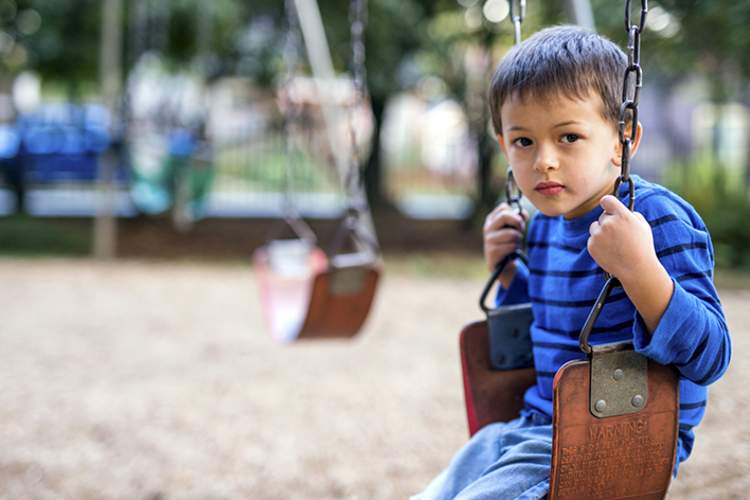 Lonely child on a swing.