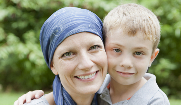 Mother with cancer poses with her young son.
